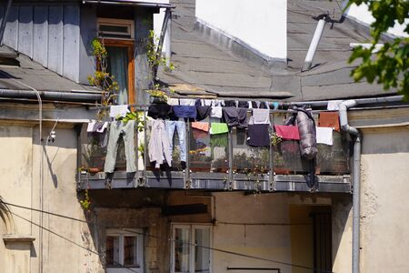 drying things on the balcony or railing is an old way to dry things. the unfolding of things in the sun, pull the ropes between the houses for drying things on the balcony or the railing is an old method to dry clothes. the unfolding of things in the sun