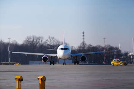 Krakow, Poland 04.01.2019: Airplane Airbus A321 at the airport. Cancellation or resumption of flights, pandemic 2020. Returning people home, tourist flights, concept of recreation and vacations