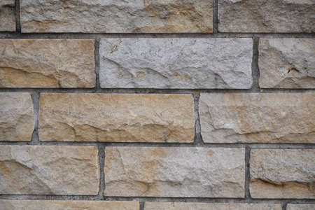Old grey brick wall texture background. Civil and industrial construction. Banque d'images