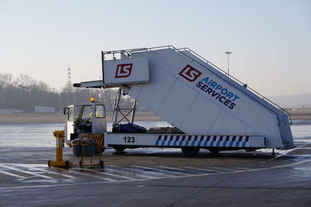 Krakow, Poland 20.12.2019: aircraft ramps on the runway waiting for the arrival of aircraft. technical machines of the airport. boarding and disembarkation of passengers