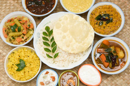Onam Sadhya, traditional Indian lunch boiled rice served with many spicy hot curries and lots of sweet dessert for Kerala harvest festival in India.