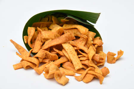 Kerala snack Pakkavada or ribbon Pakoda fried snack popular in South India Tamil Nadu, Top view Indian tea time food fried in coconut oil.