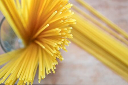 Spaghetti at the wooden background, still life photographycloseup