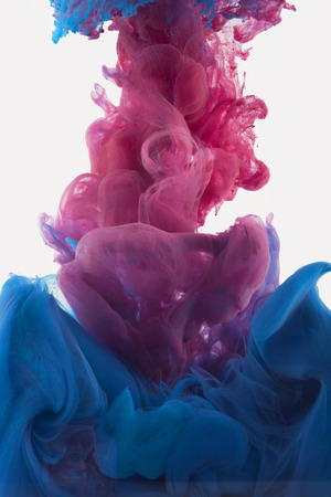 Liquid Color ink drop under water. Abstract artistic photograph, Isolated on gray background. Organic structures. 版權商用圖片