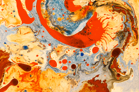 Color Liquid in dynamic flow forming interesting and unique artistic design. Colorful color tones mixing in water. Banque d'images