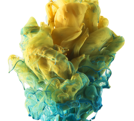 Coloud of colors. Yellow and blue ink color mixing into green in the middle. Unique abstract design