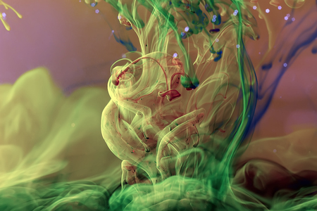 Liquid color drop in dynamic flow creating interesting and unique artistic design. Colorful color tones mixing in water. Banque d'images