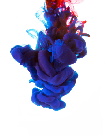 ink drop: Unique colorful abstrack design. Ink drop flowing under water. Isolated on white background. Space for text.