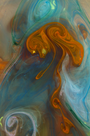 Liquid color drop in dynamic flow creating interesting and unique artistic design. Colorful color tones mixing in water. 版權商用圖片