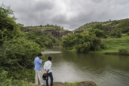 maharashtra: Ellora, India - 15th August 2016: People visiting to the caves in Ellora, Maharashtra state in India