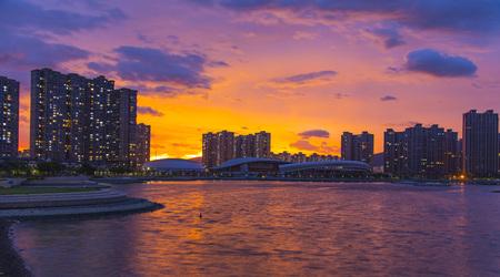 City under the setting sun Stock Photo