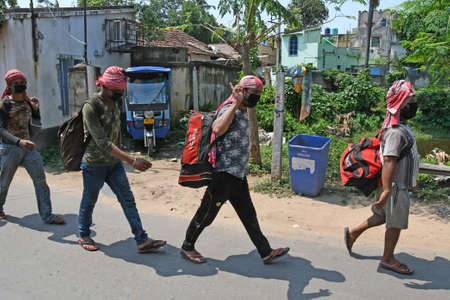 Burdwan Town, Purba Bardhaman District, West Bengal / India - 14.05.2020: Migrant workers from Kanpur are returning to their homes in the state of West Bengal on their own initiative during lockdown period due to Novel Coronavirus (COVID-19) emergence. At
