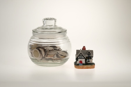 jar with coins and house