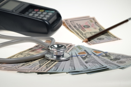 US Dollars with Stethoscope and calculator