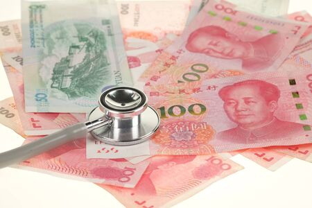 physican: Chinese yuan, renminbi money and stethoscope Stock Photo