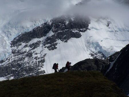 tramping: Trampers in Cascade Saddle with Dart Glacier in the background