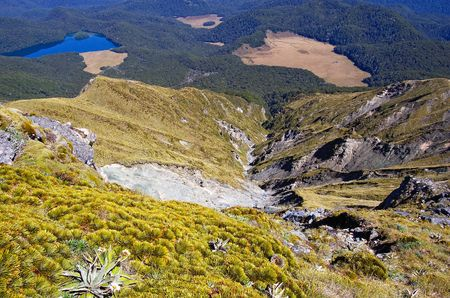 dropoff: Extremely steep rocky down-wash into Green Lake valley, Fiordland national park, New Zealand