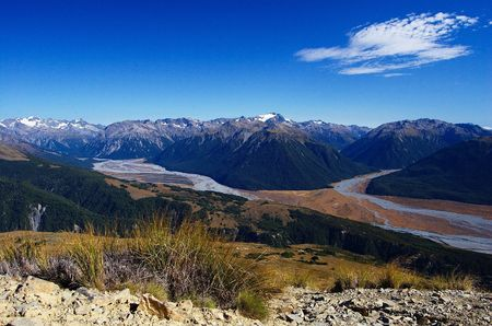 braided: Braided Waimakariri River valley and snow covered peaks and mountain ranges of Arthurs Pass national park, view from top of Mount Bruce, Craigieburn Forest park, Southern Alps, New Zealand Stock Photo