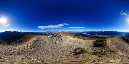 equirectangular: View from top of Mount Bruce down to Waimakariri River valley and at peaks and ranges of Craigieburn Forest park, Arthurs Pass national park, Southern Alps, New Zealand, full spheric panorama (360x180 degrees), equirectangular projection Stock Photo
