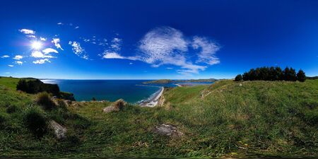 equirectangular: Heyward track, further away view at Aramoana mole and Tairoa Head with lighthouse and albatross colony, entry to Otago Harbour, Dunedin, New Zealand, full spheric panorama (360x180 degrees), equirectangular projection Stock Photo