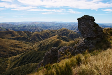 mountain ranges: View from The Gap in North direction, rock formation, mountain ranges, pastures, and farm roads, Silver Peaks, Dunedin, New Zealand