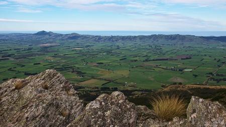 spaciousness: Vast space of Taieri Plains with Saddle Hill, Scroggs Hill, Allanton, and Dunedin airport from Maungatua Eastern Spur, Dunedin, New Zealand
