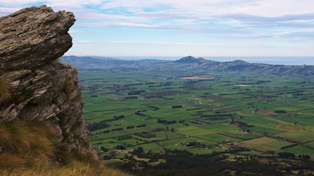 spaciousness: Spaciousness of Taieri Plains with Outram, Mosgiel, Saddle Hill, Scroggs Hill and Allanton, in contrast with rocky outcrop on Maungatua Eastern Spur, Dunedin, New Zealand