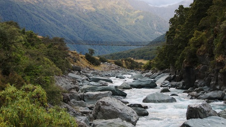 Wire bridge over Matukituki River by turn-off to Rob Roy Glacier, Mount Aspiring National Park, Otago, New Zealand photo