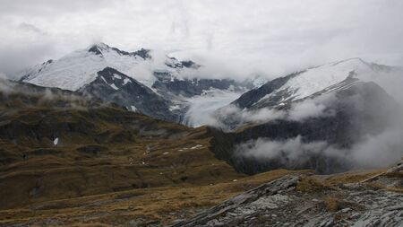 dropoff: Cascade Saddle (1524m), Plunket Dome (2191m), Mount Edward (2620m), Dart Glacier, view from Pylon, Mount Aspiring National Park, New Zealand