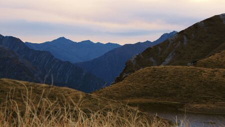 aspiring: Layered mountains in early morning light, Mount Aspiring National Park, New Zealand