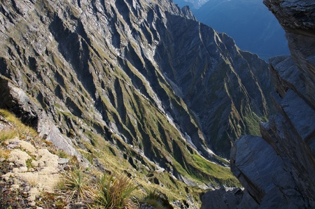 dropoff: Near vertical descent from Cascade Saddle (1524m), Mount Aspiring National Park, New Zealand Stock Photo
