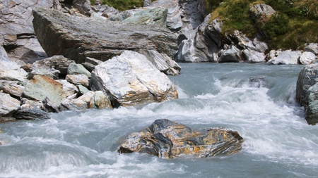 silty: Silty water of Snowy Creek by the upper bridge, Mount Aspiring National Park, New Zealand
