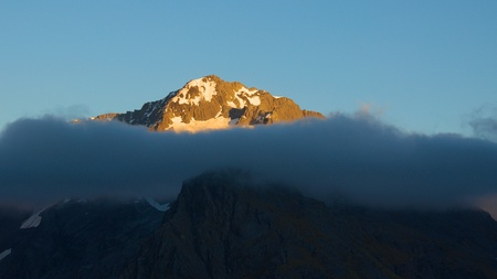 aspiring: Mount Armstrong  2174 metres  in early morning sunlight, Mount Aspiring National Park, Otago, New Zealand Stock Photo
