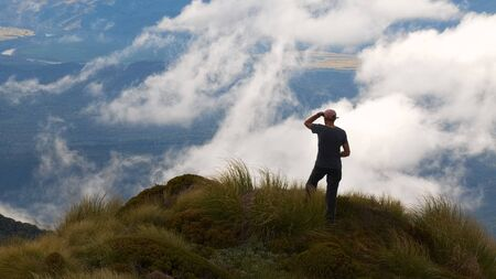 tramping: Tramper above Monowai Valley, Green Lake area, Fiordland National Park, Southland, New Zealand Stock Photo