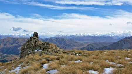 ranges: Rock formation and distant ranges, Mount Somers Track, Canterbury, New Zealand
