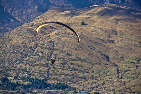 paraglider: Airborne paraglider, Queenstown Hill in background, Otago, New Zealand