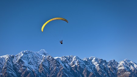 Paraglider above Remarkables range, Queenstown, Otago, New Zealand