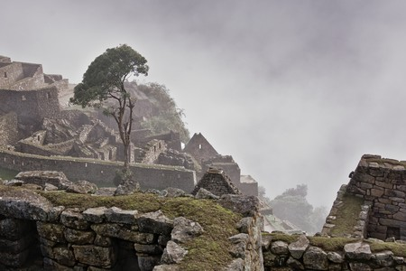 cusco: Mist in Machu Picchu ruins, Cusco, Peru Stock Photo