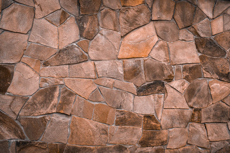 Textured texture of an old stone wall. Wallpaper for background and design