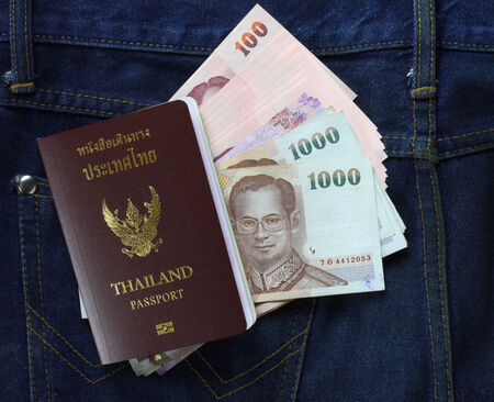 Cash and Thai passport on jeans photo