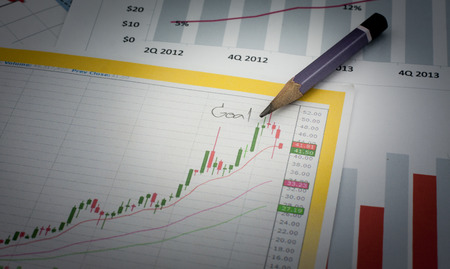 financial figure: Pencil  write the target and success Stock Photo
