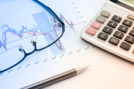 account executives: Glasses and Pencil:Analysis charts and graphs of sales -successful corporate business