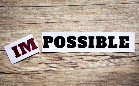 overcoming adversity: Word impossible transformed into possible. Motivation philosophy concept.Concepts of problem solving, overcoming challenges and success.