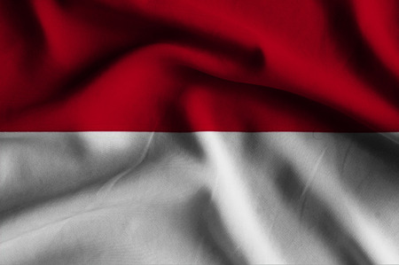 and has: Flag of Monaco.Flag has a detailed realistic fabric texture. Stock Photo