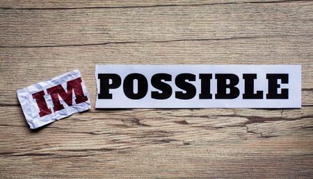 feasible: Word impossible transformed into possible. Motivation philosophy concept.Concepts of problem solving, overcoming challenges and success.