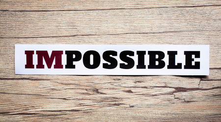 overcoming: Word impossible. Motivation philosophy concept.Concepts of problem solving, overcoming challenges and success. Stock Photo