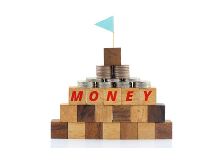 managing money: Wooden blocks forming the word MONEY and Thai coin on the white background with concept image.