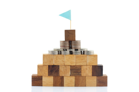 managing money: Wooden blocks and Thai coin  on the white background with concept image.