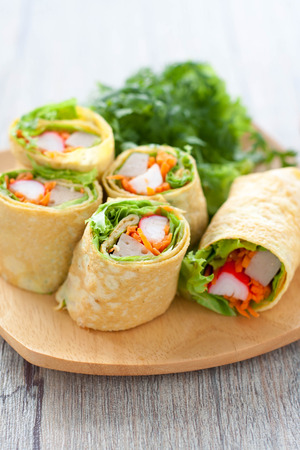common bean: Vegetarian food,Homemade egg rolls and Sweet chili sauce on wood table Stock Photo
