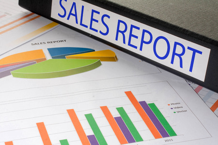 sales report: Black document binders with the label sales report